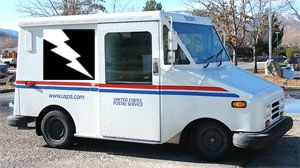 image: US postal service electric freight truck delivery vehicle full load truck rail terminal