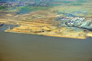 image: UK logistics park freight throughput port-centric container shipping deep sea Thames London Gateway intermodal wagons
