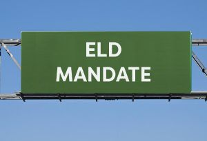 image: US ELD mandate trucking tachograph driver hours of service in cab technology freight logistics TMS logistics