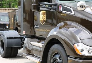 image: UPS US compressed natural gas fleet environmentally truck tractor commercial vehicles one billion dollar