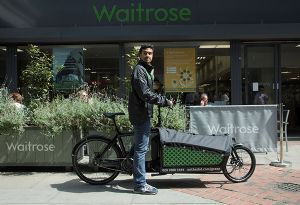 image: UK Waitrose urban retail logistics cargo bikes vans on the dot