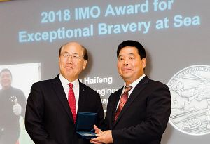 image: UK China International Maritime Organization bravery at sea awards merchant ship sunk