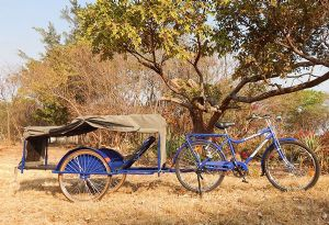 image: UK Zambia Transaid Goodyear Tyre ambulance bicycle malaria transport logistics