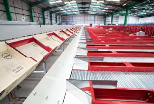 image: UK the Delivery group mail sorting eCommerce square foot warehouse 25,000 staff