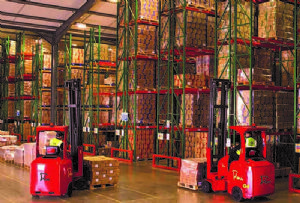 image: UK Flexi Narrow Aisle articulated fork lift trucks refurbished racking systems handling freight manufacturing
