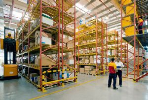image: Singapore DHL Supply Chain digital facility warehouse freight Tetra Pak packaging food handling container storage