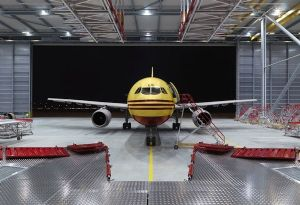 image: Denmark DHL Express parcel carrier logistics hub airport investment