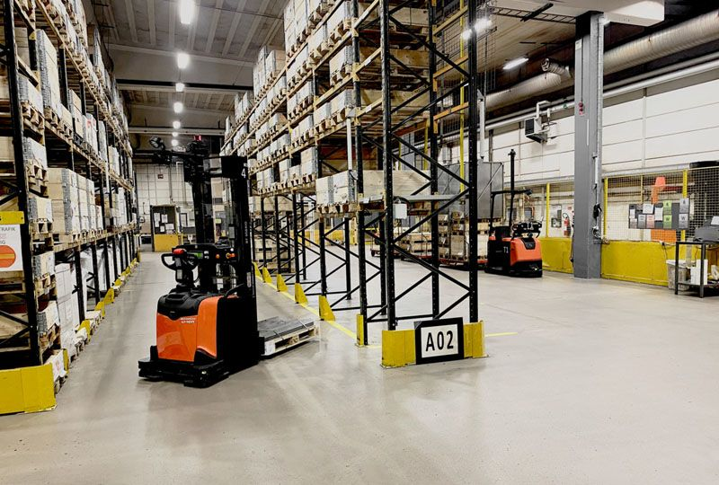 image: UK, Toyota, fork, lift, truck, automation, logistics, road. Haulage, HGV, drivers,